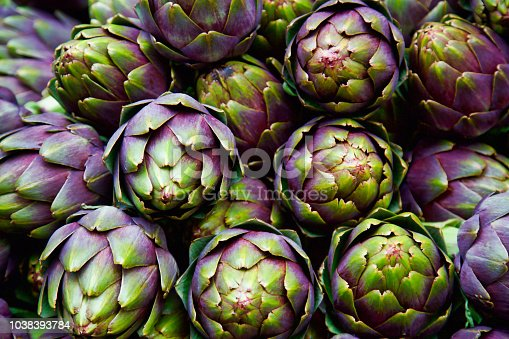 full frame of purple italian artichokes at the farmer's market