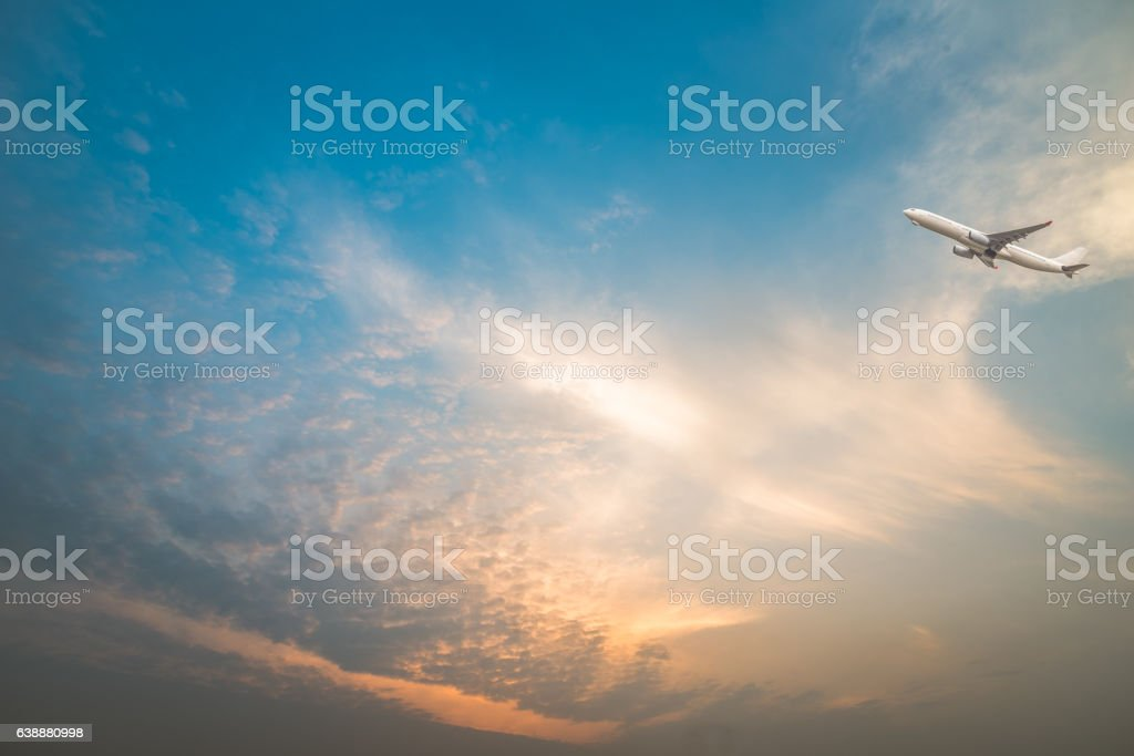 full frame shot of  cloudscape with a plane flying over stock photo