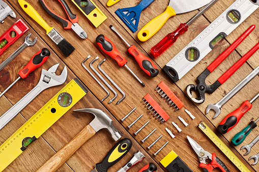 Full frame shot of hand tools diagonally arranged on table