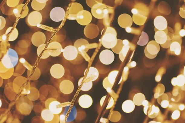 full frame shot of illuminated string lights and bokeh - christmas lights imagens e fotografias de stock