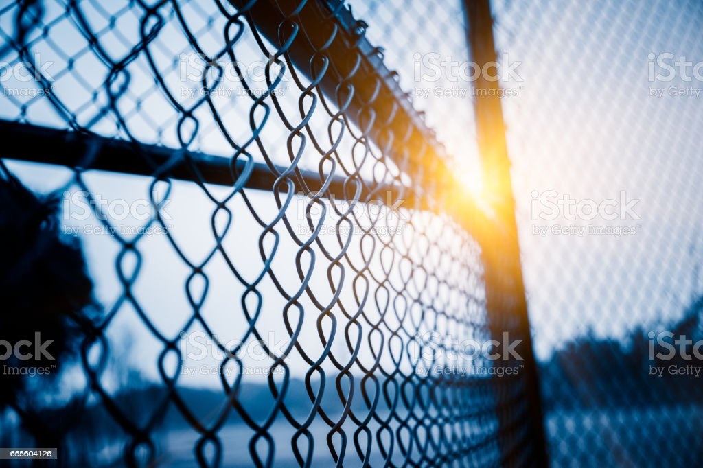 full frame shot of mesh wire fence stock photo