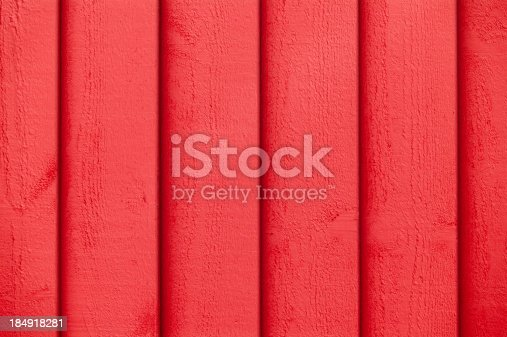 1124475954 istock photo Full frame view of red paint on the wooden wall 184918281