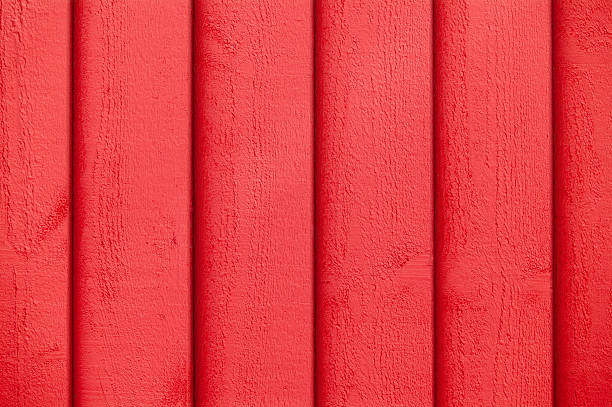 Full frame view of red paint on the wooden wall stock photo