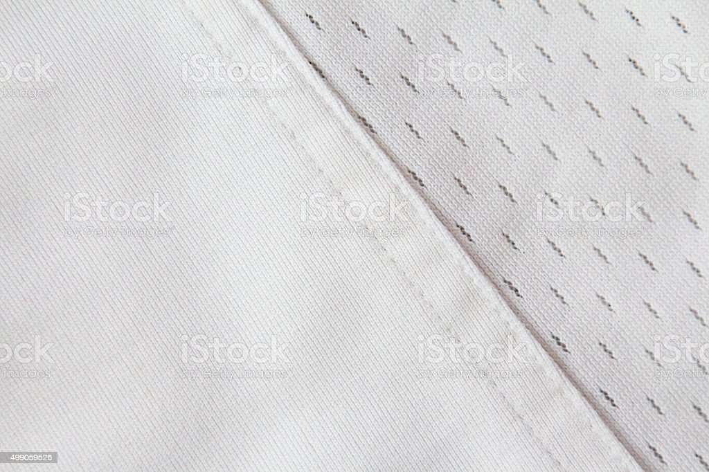 Full frame white jersey with diagonal seam stock photo
