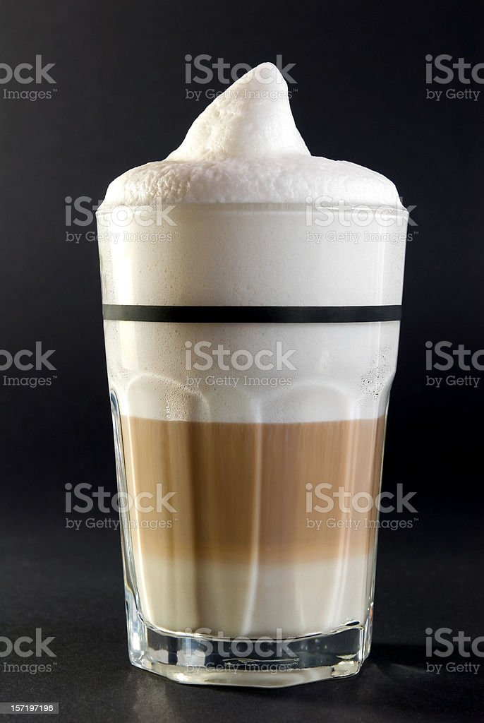 Full glass of coffee with foam on top royalty-free stock photo