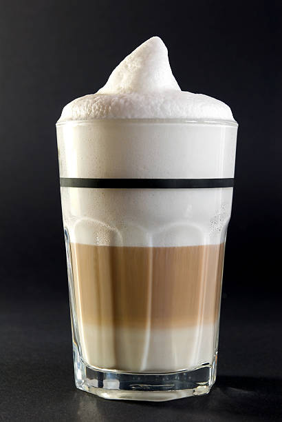 Full glass of coffee with foam on top stock photo