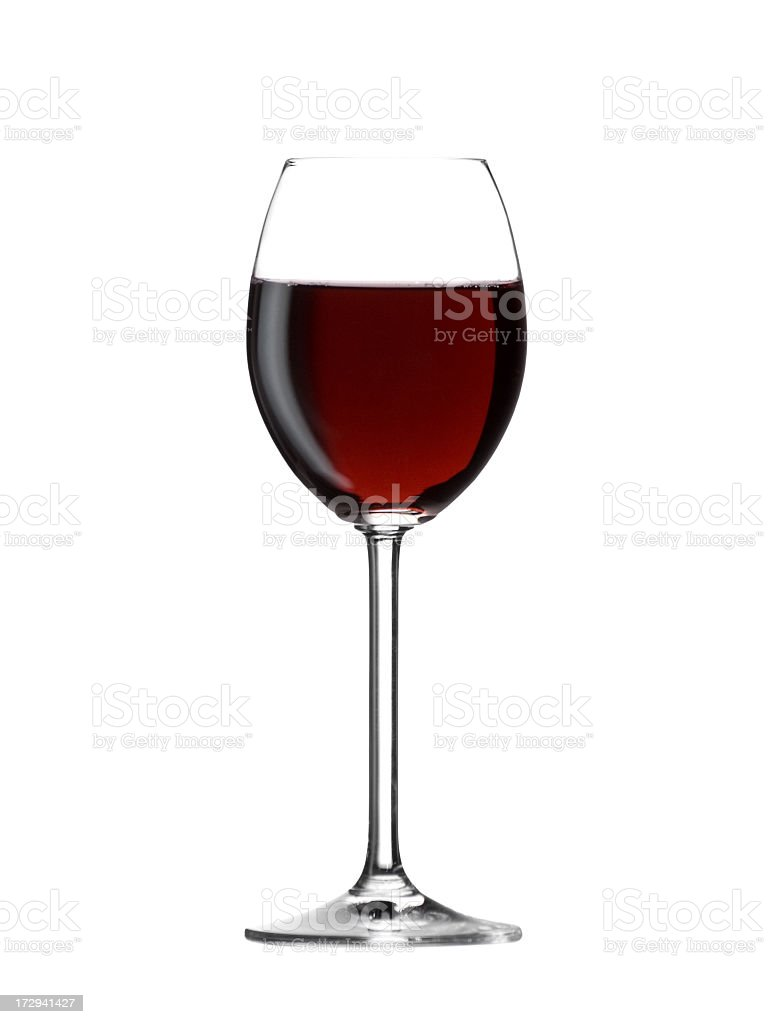 Full glass of red wine set against a white backdrop royalty-free stock photo