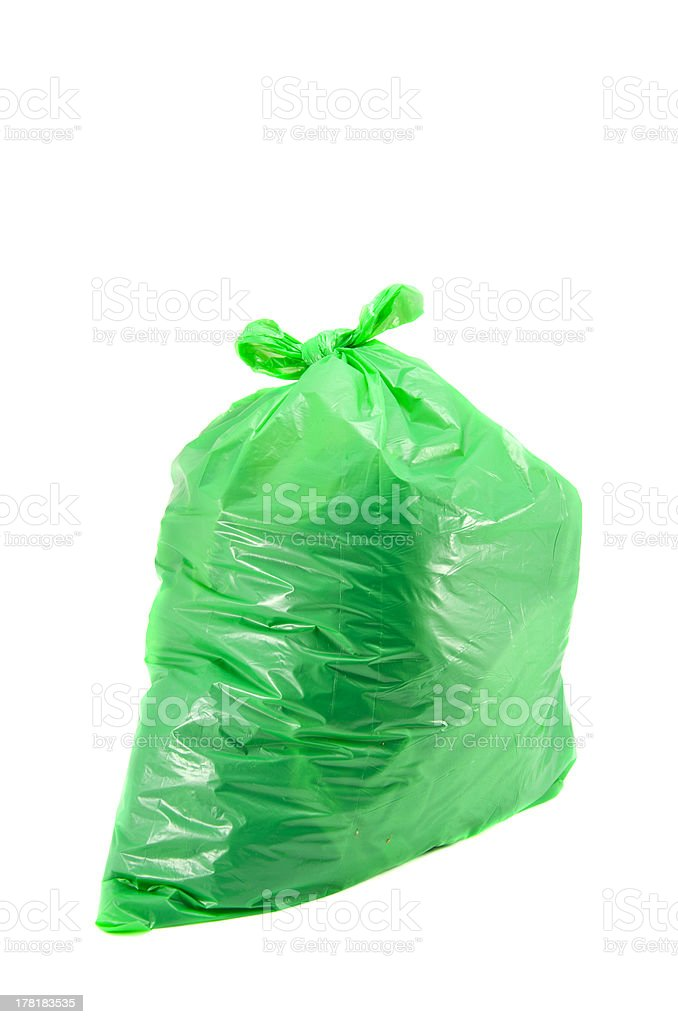 full green garbage bag isolated stock photo