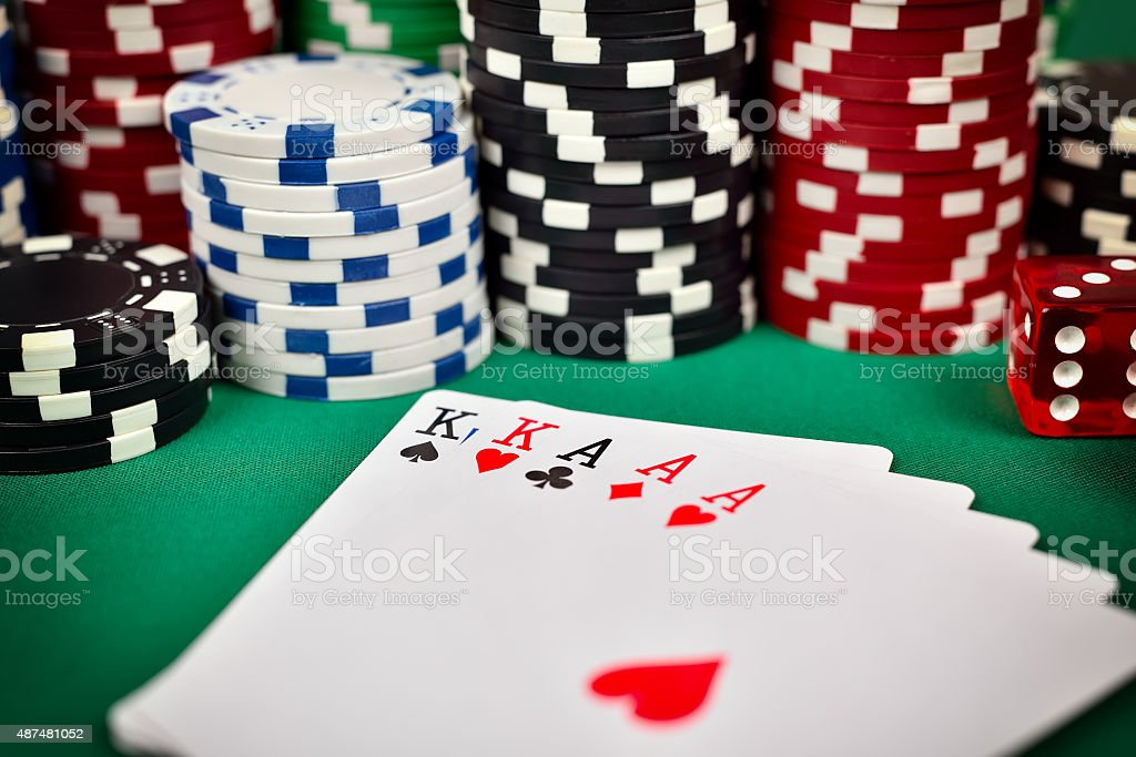 full house and poker chips stock photo