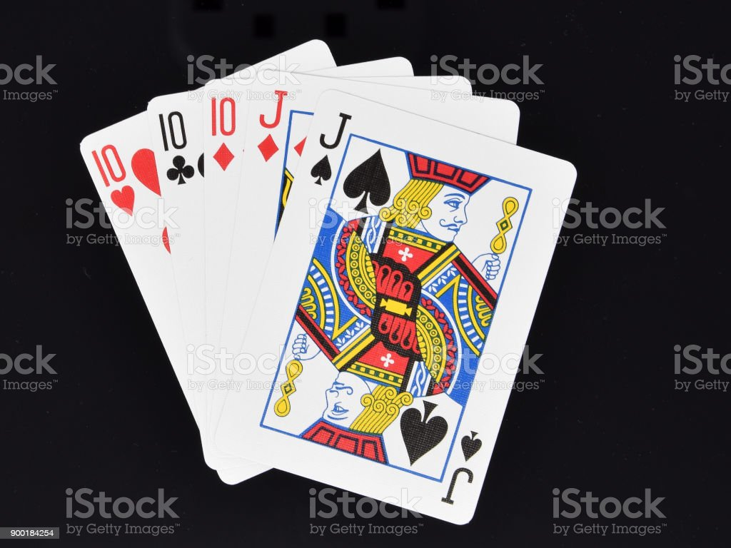 Full House hand in poker card game stock photo