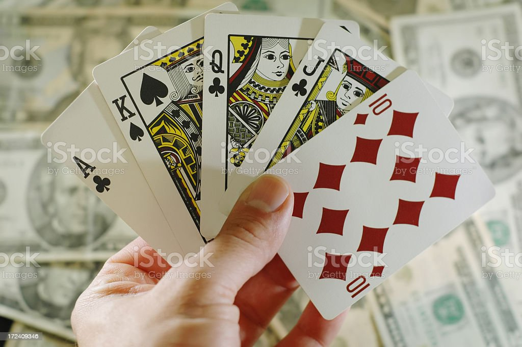 Full house playing cards with money background royalty-free stock photo