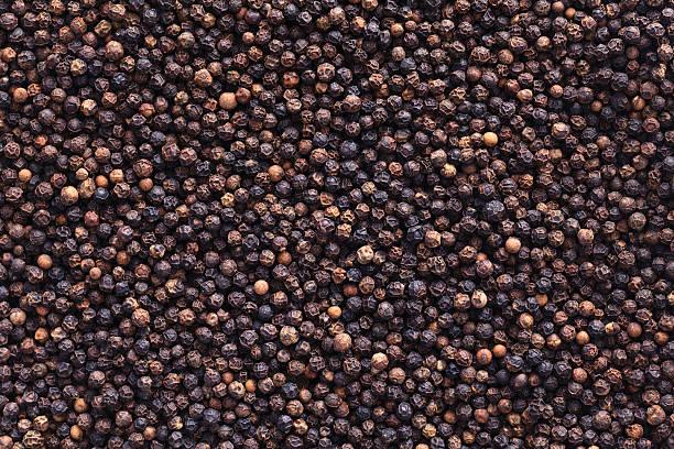 full image of peppercorns as a background - tane biber stok fotoğraflar ve resimler