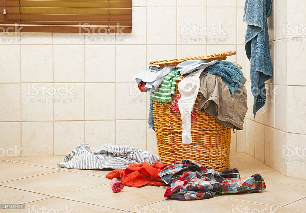 Full laundry hamper stock photo