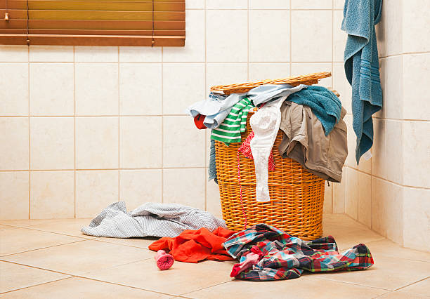 Full laundry hamper A laundry hamper in a bathroom laundry basket stock pictures, royalty-free photos & images