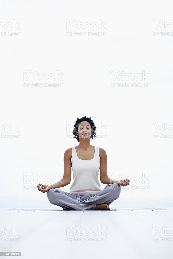 Full length African-American woman meditating royalty-free stock photo