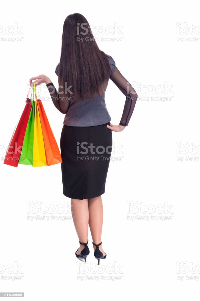 Full Length Backside Portrait of Young Woman With Shopping Packages. stock photo