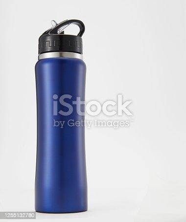 1129148925 istock photo Full length blue aluminium waterbottle. Isolated on white background. 1255132780