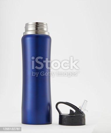 1129148925 istock photo Full length blue aluminium waterbottle. Isolated on white background. 1255132781