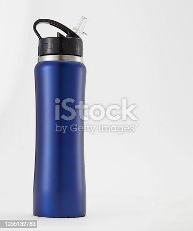 1129148925 istock photo Full length blue aluminium waterbottle. Isolated on white background. 1255132783