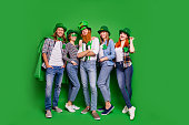 Full length body size photo cheer company five friends tradition national day funny funky specs casual outfit clothes saint paddy day laugh laughter isolated on bright vivid green background