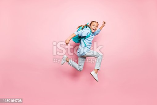 istock Full length body size photo of cheerful excited crazy positive girl running fast with rucksack behind her back wearing blue sweater jeans denim isolated over pink pastel color background 1180164708