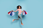 istock Full length body size photo of crazy cheerful nice cute fascinating nice youngster having returned from black friday mall in striped t-shirt pants trousers footwear isolated blue pastel color background 1180983358