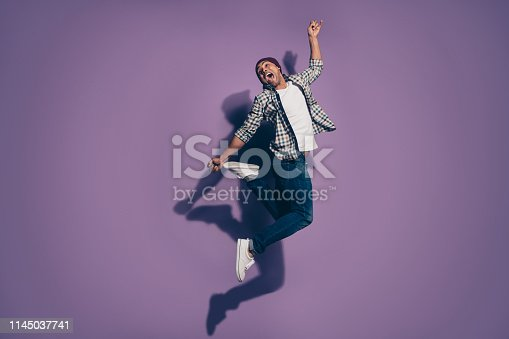 925466128 istock photo Full length body size photo of crazy nice handsome glad optimistic cool delightful in denim clothes person jumping up isolated violet background 1145037741