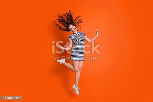 1054970060istockphoto Full length body size photo of pretty attractive enjoying golden season nice glad cheerful confident she her student people person graceful elegant glamorous lady isolated vivid background 1145022897