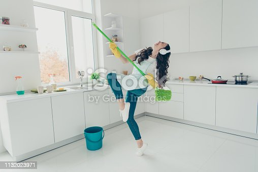 1081403344 istock photo Full length body size portrait of her she nice adorable beautiful cheerful wavy-haired house-wife using broom dancing having fun in modern light white interior indoors 1132023971