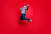 istock Full length body size portrait of nice funny glad handsome cheerful positive trendy guy wearing checkered shirt showing winning gesture cool party in air isolated on bright vivid shine red background 1097434276