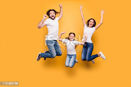 Full length body size portrait of nice lovely adorable attractive positive cheerful people dad daddy mom mommy spending spare free time isolated over shine vivid pastel yellow background.