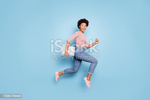 Full length body size profile side photo of excited crazy cheerful positive nice pretty, sweet youngster wearing jeans denim striped shirt footwear isolated blue pastel color background