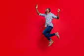 istock Full length body size profile side view of nice funny crazy handsome cheerful guy wearing checkered shirt holding in hands cell reading text going in air isolated on bright vivid shine red background 1097437904