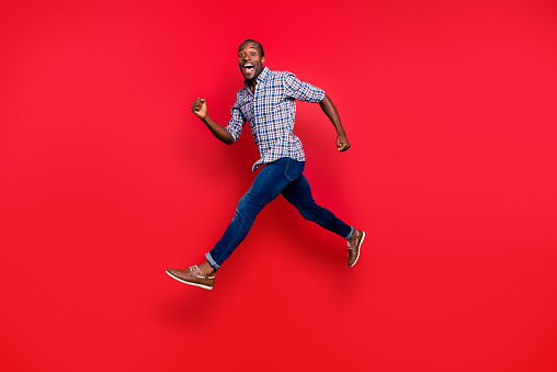 istock Full length body size profile side view of nice funny handsome cheerful positive sportive guy wearing checkered shirt running in air isolated on bright vivid shine red background 1097432730