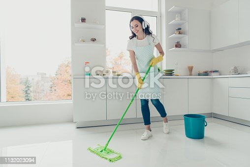 1081403344 istock photo Full length body size side profile photo beautiful attentive hardworking nice pleasant duties she her lady house ear flaps head wear jeans denim casual t-shirt covered cute apron bright light kitchen 1132023094