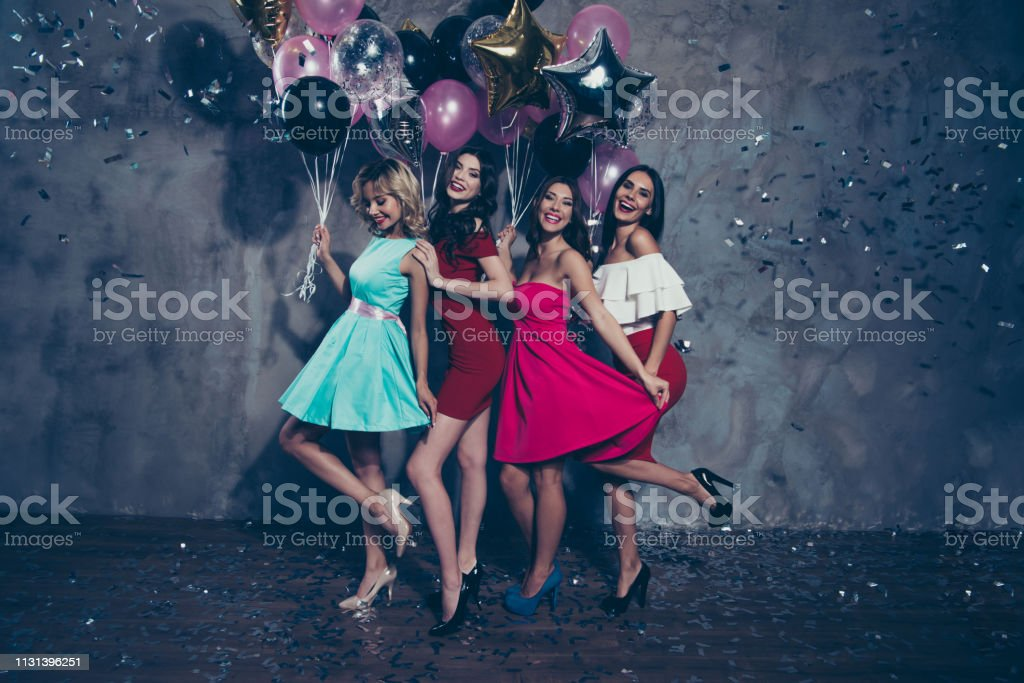 Full length body size view of four nice lovely fascinating chic attractive gorgeous cheerful positive ladies enjoying free time clubber having fun over gray concrete wall Full length body size view of four nice lovely fascinating chic attractive gorgeous cheerful positive ladies enjoying free time clubber having fun over gray concrete wall. Adult Stock Photo
