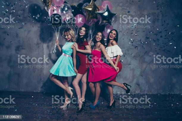 Full Length Body Size View Of Four Nice Lovely Fascinating Chic Attractive Gorgeous Cheerful Positive Ladies Enjoying Free Time Clubber Having Fun Over Gray Concrete Wall Stock Photo - Download Image Now