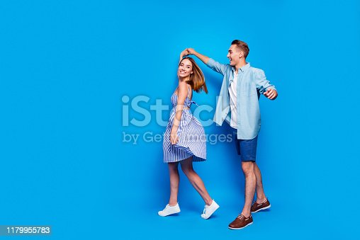 Full length body size view of her she his he two nice attractive charming, lovely cheerful partners dancing spinning waltz isolated over bright vivid shine vibrant blue turquoise color background