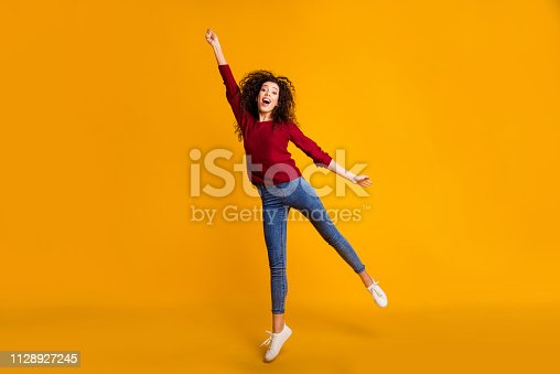 Full length body size view of her she nice lovely attractive cheerful funny slim thin fit wavy-haired lady vacation weekend holding invisible umbrella isolated on bright vivid shine orange background
