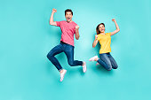 Full length body size view of his he her she nice attractive crazy overjoyed cheerful couple jumping up in air having fun time rejoicing isolated on bright vivid shine vibrant green turquoise background
