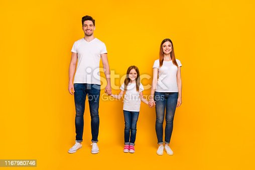 istock Full length body size view of three nice-looking attractive charming stylish trendy cheerful person holding hands spending weekend isolated over bright vivid shine yellow background 1167980746