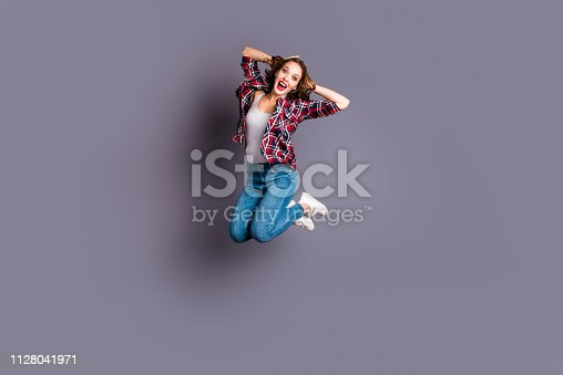 istock Full length body size view portrait of her she nice cool shine look attractive adorable sporty lovely charming pretty cheerful cheery wavy-haired lady omg life isolated over gray background 1128041971