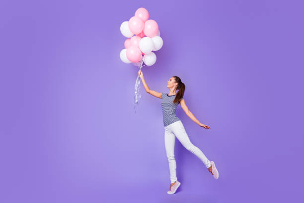 full length body size view portrait of her she nice-looking attractive lovely charming cheerful cheery girl dancing with helium balls isolated over violet purple vivid shine bright background - mulher balões imagens e fotografias de stock