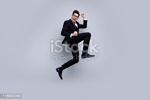 925466128 istock photo Full length body size view portrait of his he nice elegant attractive crazy cheerful cheery guy diplomat executive manager rejoicing holiday career growth isolated over light gray background 1150502353