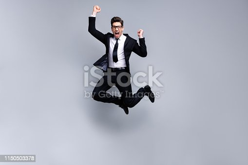 925466128 istock photo Full length body size view portrait of his he nice elegant imposing attractive crazy cheerful guy diplomat white collar celebrating holiday career growth isolated over light gray background 1150503378