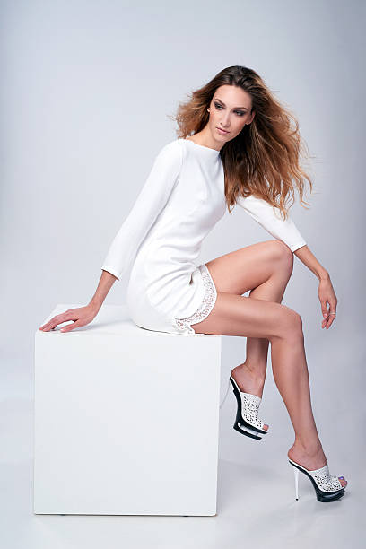 full length fashion model in gorgeous dress - mini dress stock photos and pictures