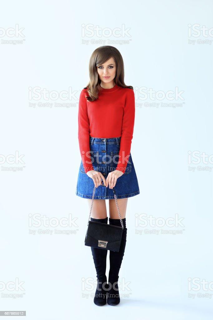 Full length fashion portrait of shy beautiful woman in retro style stock photo