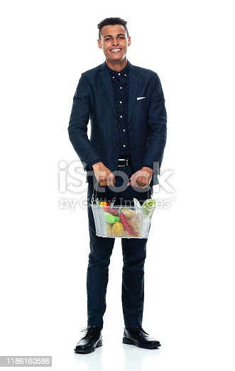 istock Full length / front view / one man only / one person of 20-29 years old adult handsome people black hair / short hair african ethnicity / african-american ethnicity male / young men businessman / business person standing wearing a suit / retail 1186160586