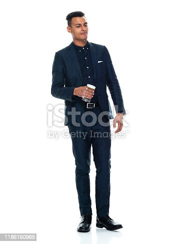 istock Full length / front view / one man only / one person of 20-29 years old adult handsome people black hair / short hair african ethnicity / african-american ethnicity male / young men businessman / business person wearing a suit who is drinking / drunk 1186160965