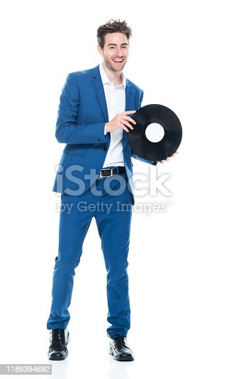 Full length / front view / one man only / one person of 30-39 years old adult handsome people brown hair caucasian male / young men business person / businessman dancing / exercising wearing business casual / smart casual / businesswear / open collar / button down shirt / shirt / blazer - jacket / jacket / a suit who is smiling / happy / cheerful / laughing / joy / listening and holding record / music